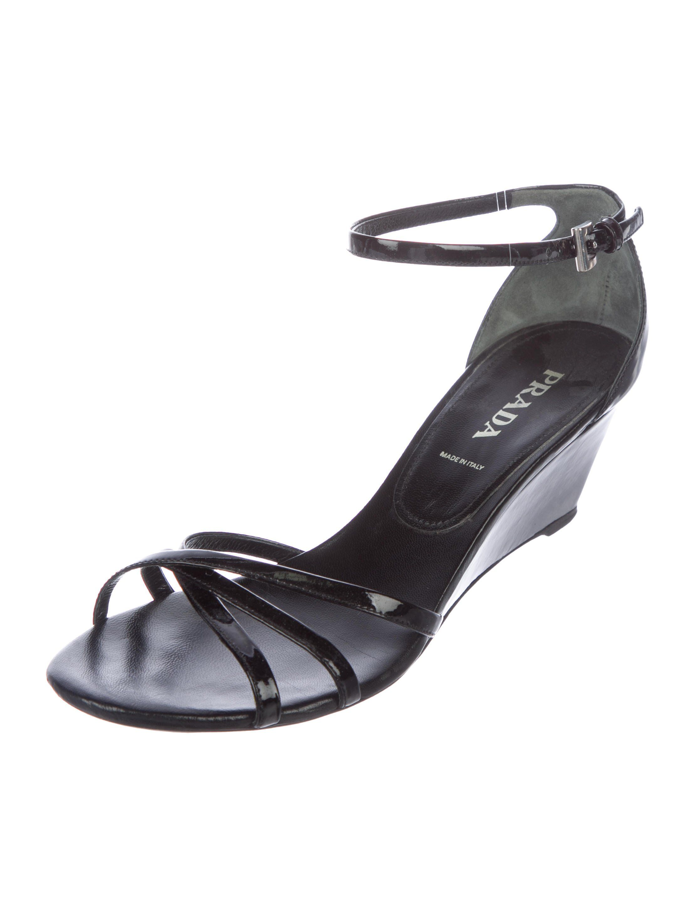 dee81291bc6b Black Vernice leather Prada round-toe wedge sandals with crossover straps  at vamps