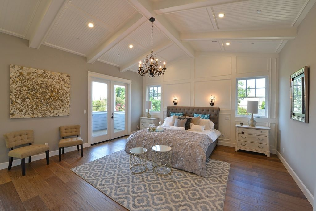 Traditional master bedroom with carpet cathedral ceiling for Cathedral ceiling beams