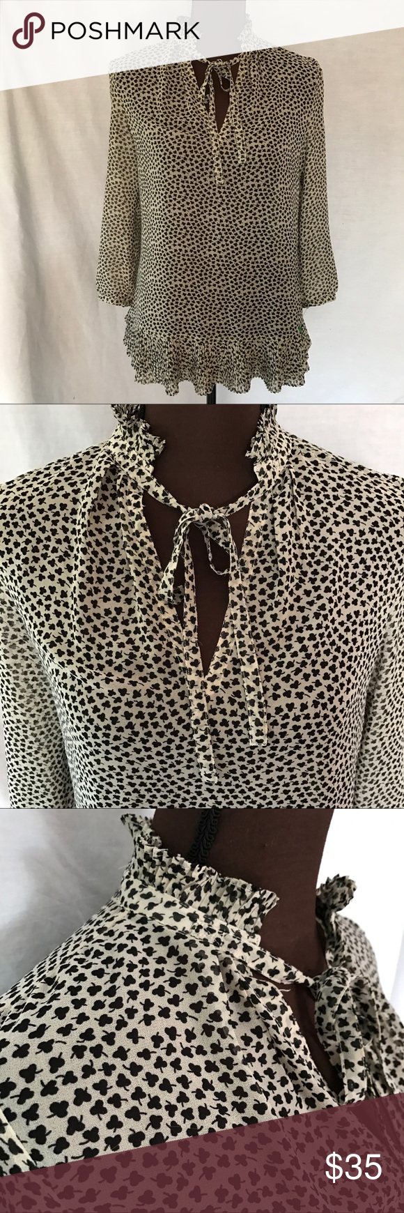 Anthro Portrait of a Girl Shamrock Sheer Blouse Semi-Sheer top dotted with little shamrocks from Portrait of a Girl. The neck has a short ruffle collar with a thin tie in the front. The bottom flairs out into a soft ruffle. EUC this shirt is free of major flaws like tears or stains.    ✅20% Off Bundles   ✅Questions Welcomed   ✅Reasonable Offers   ⛔️Trades   ⛔️Offline Transactions   Thrift is Sexy 💋👠 Anthropologie Tops Blouses