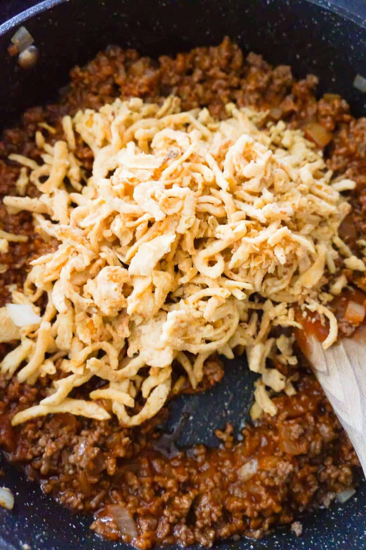 French S Fried Onions On Top Of Sloppy Joe Mixture In A Saute Pan In 2020 Beef Recipes Easy Ground Beef Casserole Recipes Beef Casserole Recipes