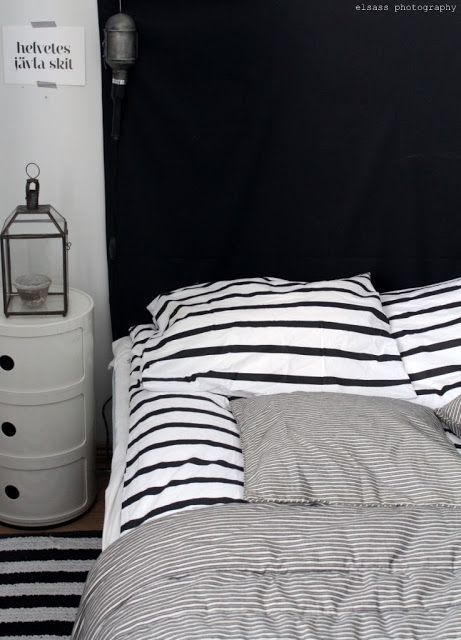 Black and white Stripes on bed. This is my kind of room. I love stripes...