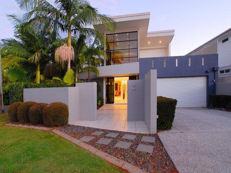 Glass modern house exterior with bay windows fountain House