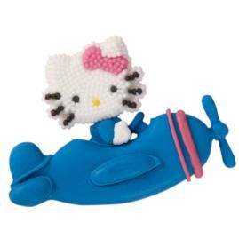 Hello Kitty Icing Decorations take to the friendly skies, via cookie airplanes created using our pattern and royal icing details.