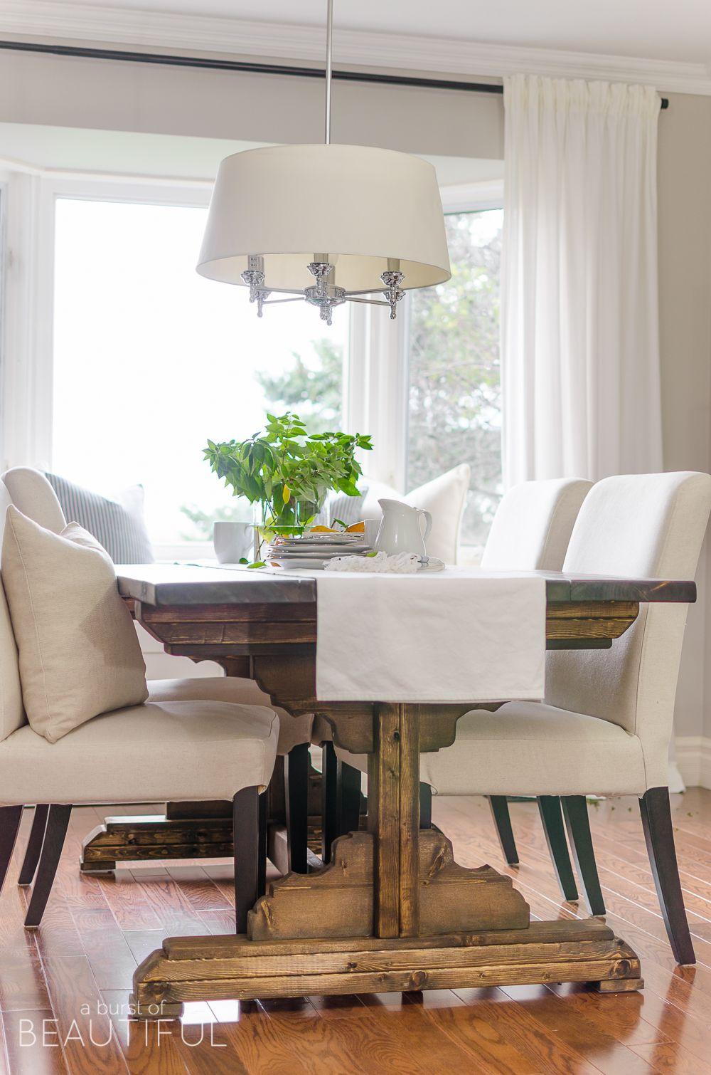 A Bright And Inviting Dining Room Boasts Simple Farmhouse Style With DIY Table Classic Window Bench