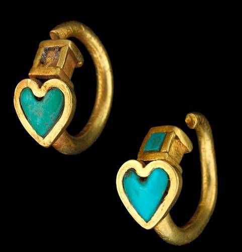 A pair of first century earrings, from a tomb in Tillia Tepe, Afghanistan | Image from when they were on display at the 'Afghanistan, Rediscovered Treasures' exhibition at Muse Guimet in 2006 in Paris, France.