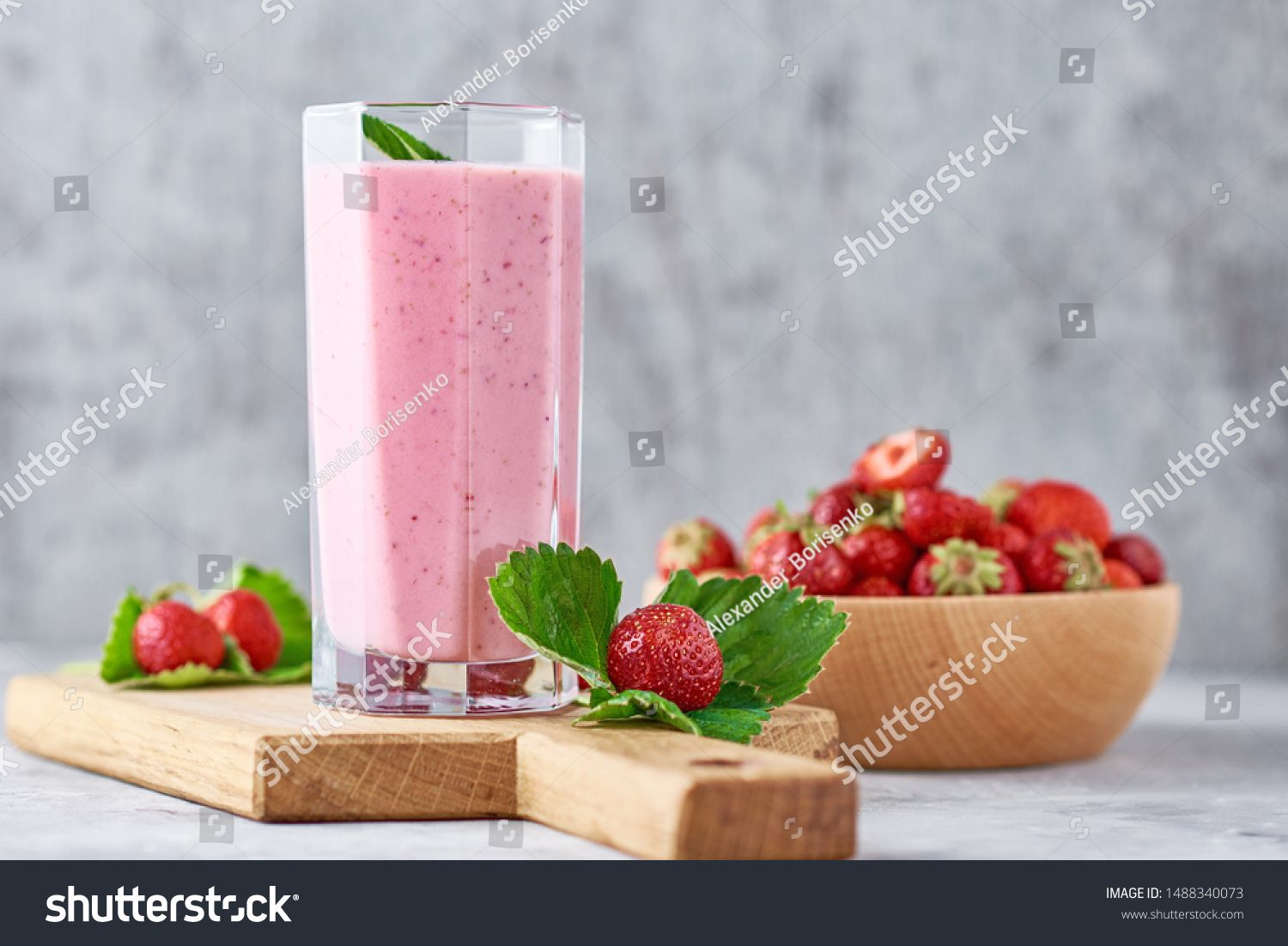 Strawberry smoothie in glass jar and fresh strawberries in wooden bowl on cutting board #Sponsored , #AD, #jar#fresh#glass#Strawberry