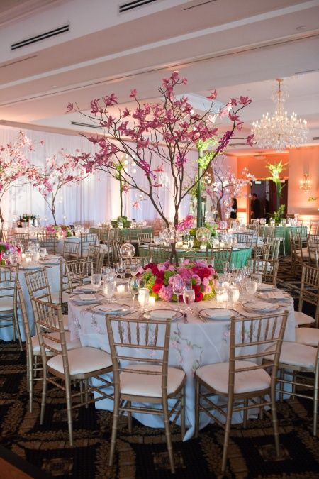 Tree centerpiece with flowers at base chiavari chairs