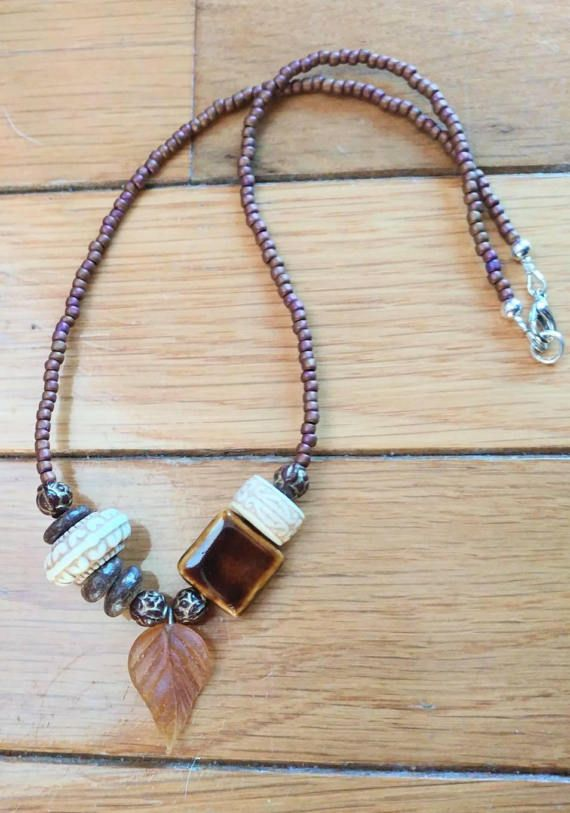 Check out this item in my Etsy shop https://www.etsy.com/listing/504705840/copper-brown-ceramic-and-wood-necklace