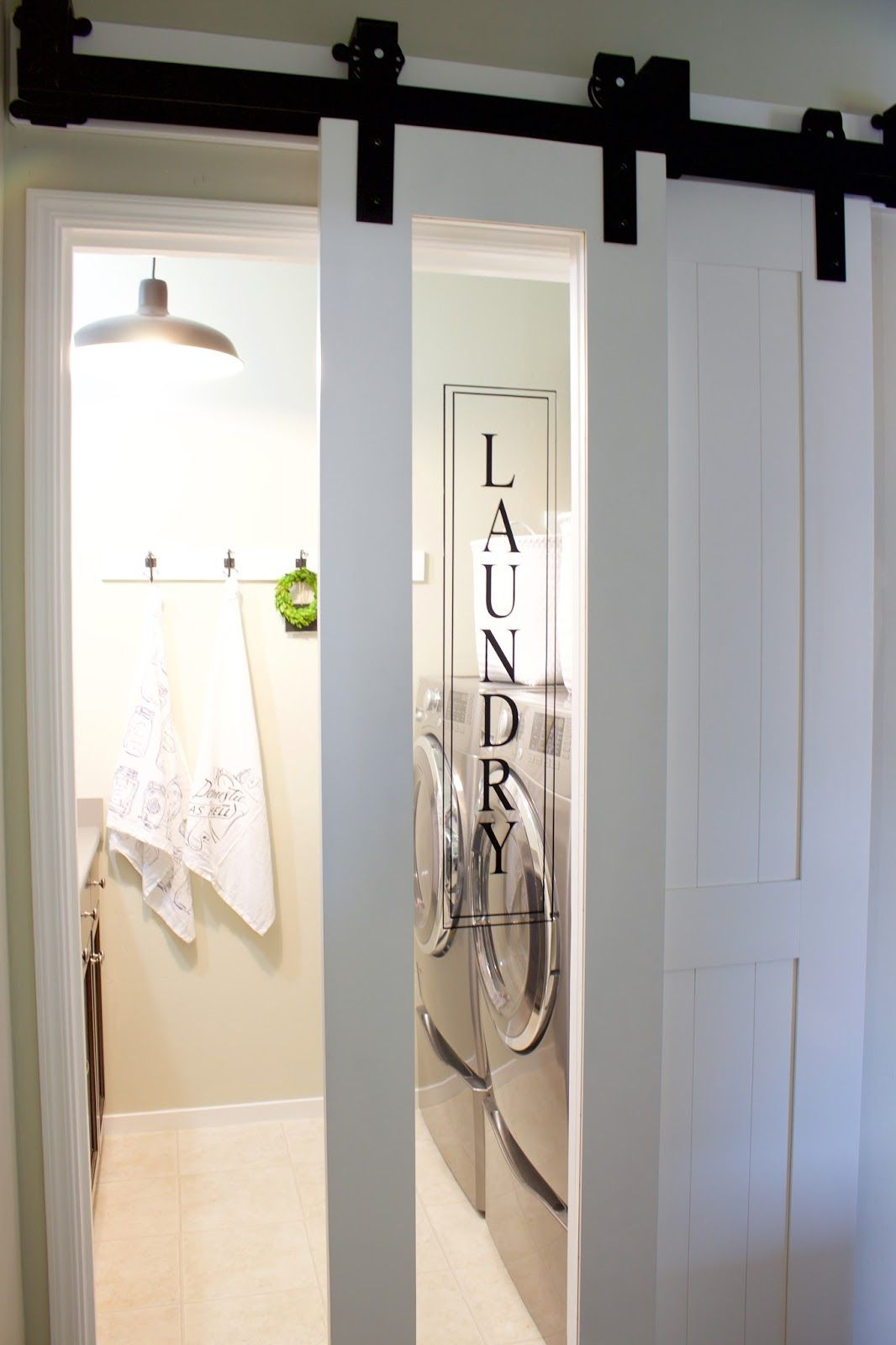 Interior Barn Door With Glass the finishing touch-a sliding barn door for the laundry room