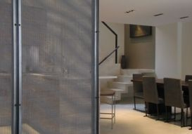 The Angle Iron Frame Sandwiches The 2 Layers Of Wire Mesh To Act Like A Transparent Room Divider For This Ny Apartment Korkuluklar Duvar Merdivenler