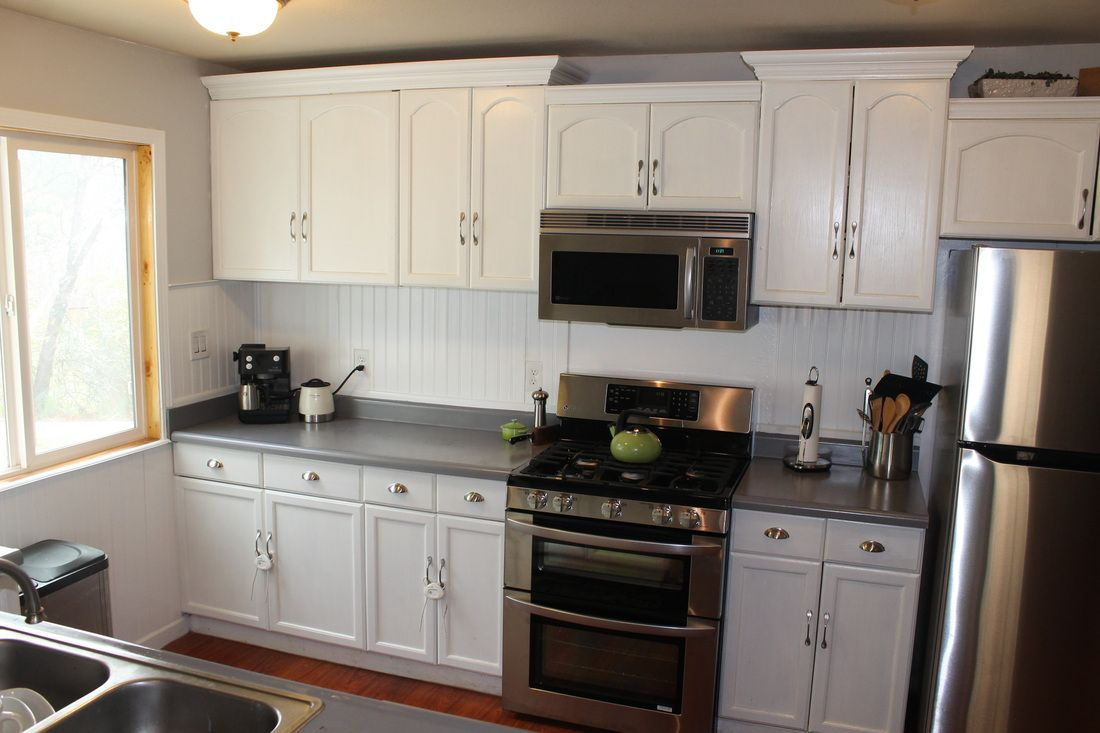 White Countertop Paint Thrifty Remodeling Before And After Rustoleum White Cabinets