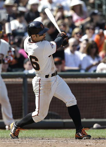 San Francisco Giants Andres Torres doubles to score Buster Posey during the seventh inning of a baseball game against the Colorado Rockies in San Francisco, Saturday, May 25, 2013. (AP Photo/Jeff Chiu)