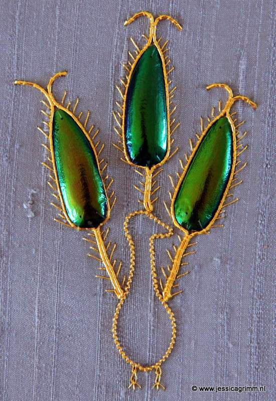 Goldwork peacock with beetle wings