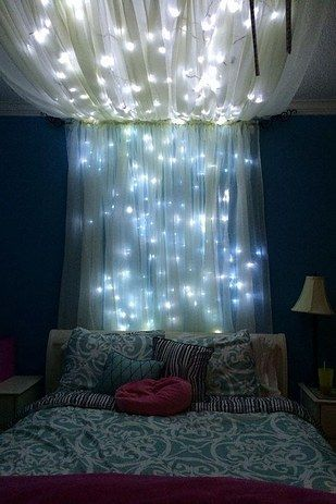 Add some string lights to create an extra whimsical effect. | 14 Dreamy DIY Canopy Beds That Will Transform Your Bedroom