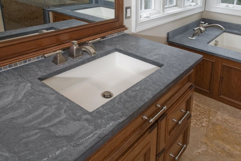 The Double Vanity Features Kohler Kathryn Undermount Sinks, Brushed Nickel  Delta Lavatory Faucets, And Honed Pietra Di Cardosa Limestone Countertops.