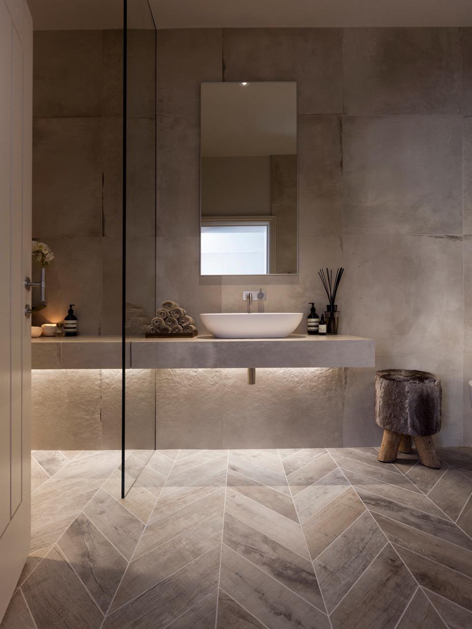Pin by llama group janey butler on llama janey butler interiors herringbone wood effect floor tiles floating shelf and glass detail ceramic concrete effect wall tiles janey butler interiors dailygadgetfo Image collections
