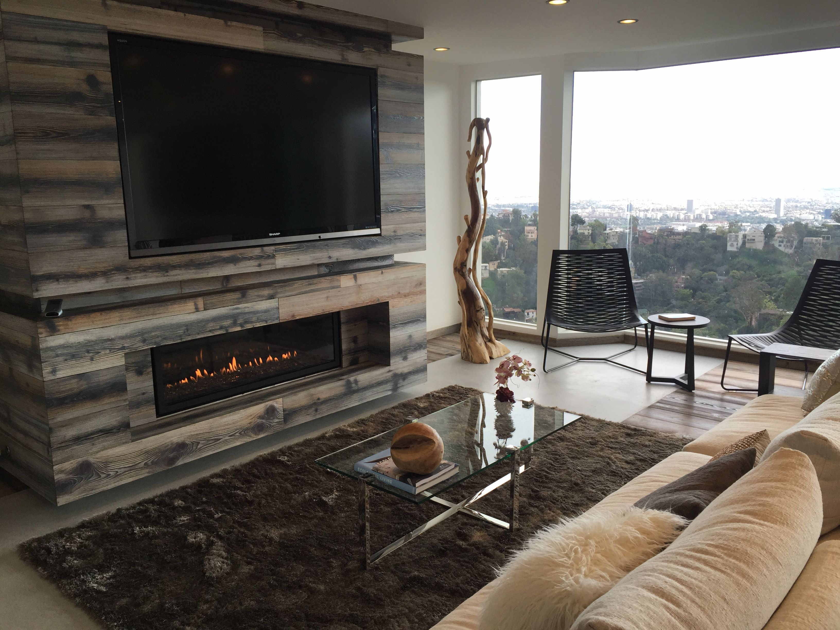 low profile gas fireplace with tv above; tv is too high for