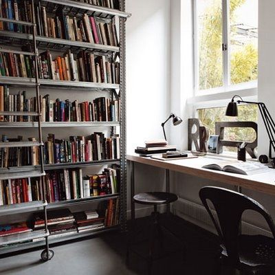 work station with great light. + floor-to-ceiling bookshelves are a fave