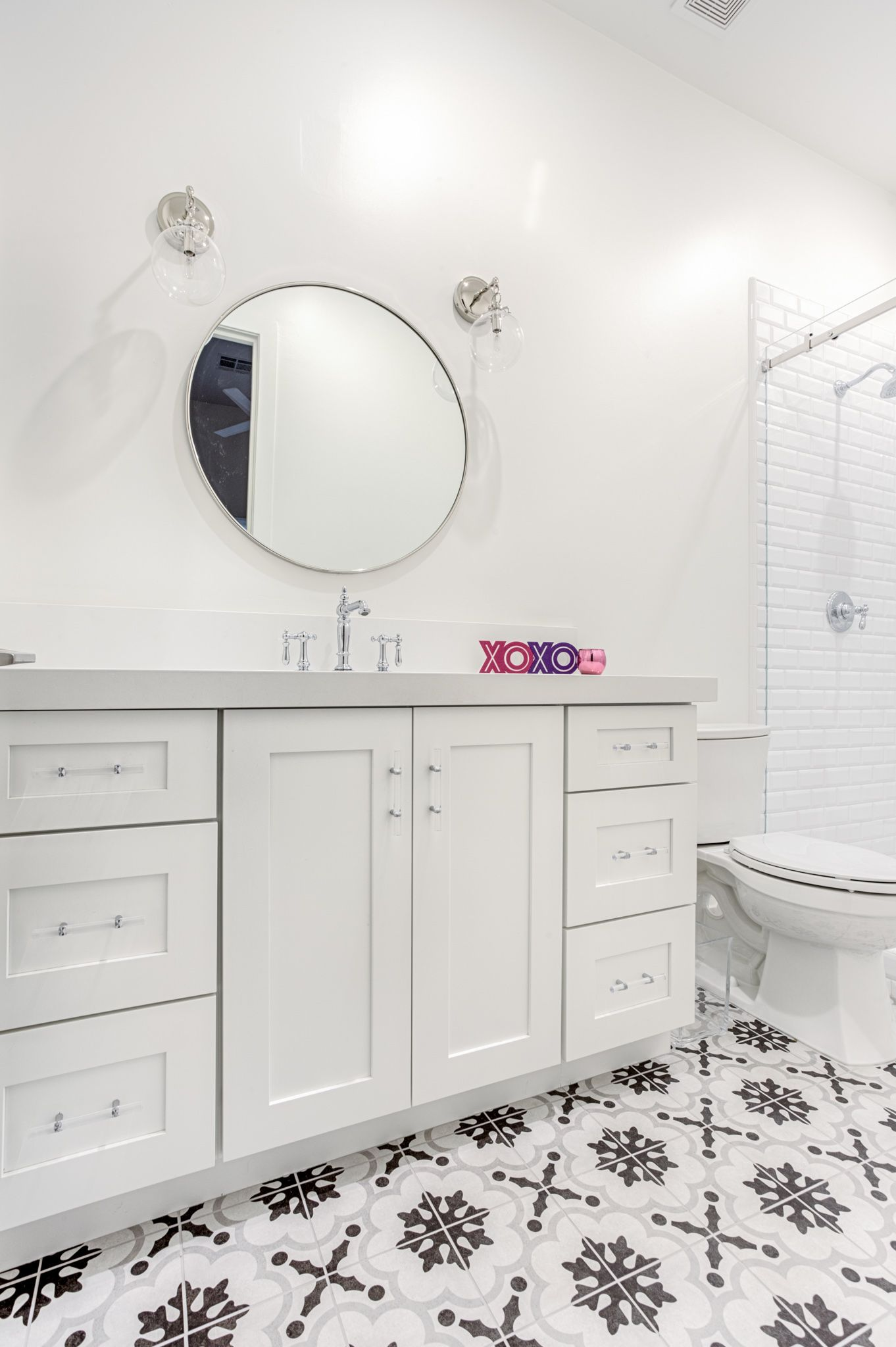 This white bathroom uses Shaker White cabinets to enhance the ...