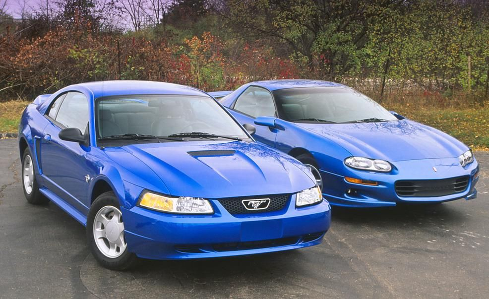 1999 Chevrolet Camaro Z28 And Ford Mustang Gt Coupes Pictures Photo Gallery Car And Driver Mustang Ford Mustang Camaro Vs Mustang