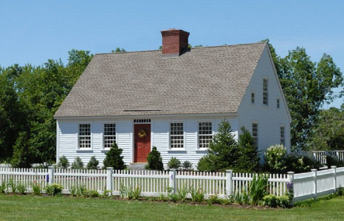 Exterior of small cape house with center chimney for Simple cape cod house plans