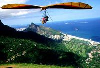 Hang glide off Sugar Loaf mountain in Rio.