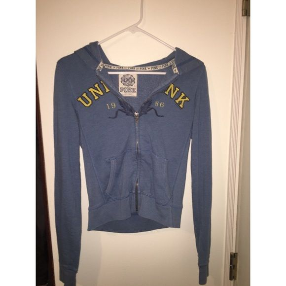 """Blue Victoria's Secret Hoodie Full-zip hoodie, gently used. Front says """"UNIV PINK"""" as implying """"university of"""". No recognisable flaws besides the fact that this is a pre-loved jacket. Still has lots of life left & needs a new home.   Brand: Victoria's Secret PINK Size: S  Message me if you have any questions!  Make offers, I'm always up to negotiate :-) ** 10% off of bundles 2 items or more ** #victoriasecret #pink #hoodie #zipup #fullzip #blue #university #college Victoria's Secret Tops…"""
