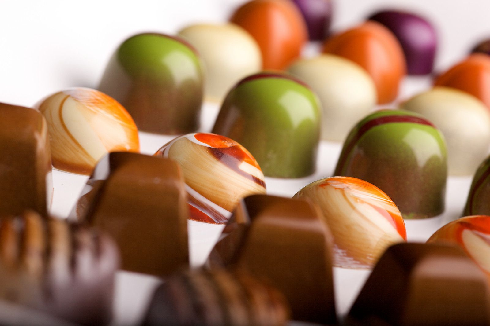 Normal Love Confections offers 36 core flavors including Praline, Tahitian Caramel, Pumpkin, Pistachio Cherry and others.