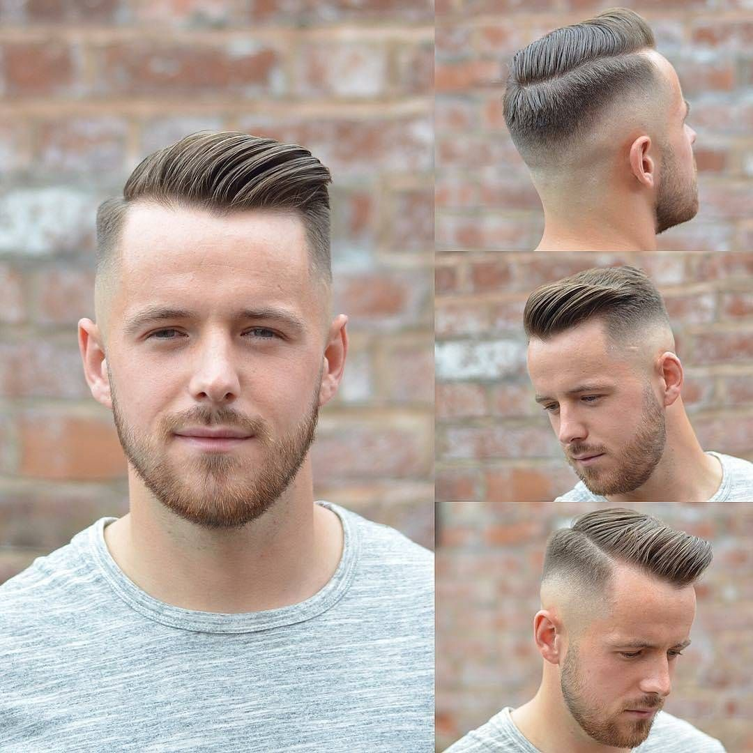 Modern haircuts men freshly cut low fade with a hard part combed to the side with bumper
