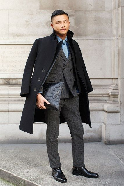 Jackie Tam, senior fashion editor, GQ China  Wearing a Neil Barrett coat, bespoke suit and Gucci bag. Photo by Dvora for GQ UK