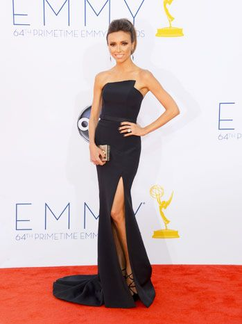 E! tv host and new mom Giuliana Rancic covered the Red Carpet arrivals at the 2012 Emmy Awards and looked beautiful in a sexy black Romona Keveza gown with a high slit. See more creations at romonakeveza.com
