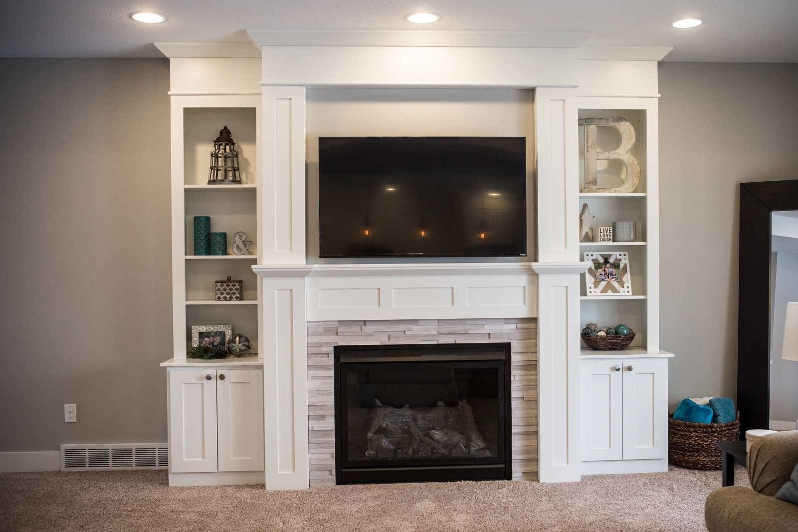 White shelving surrounding and mantel on this large