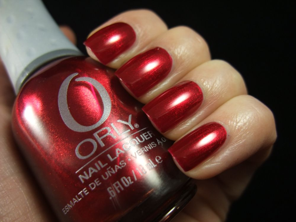 Orly - Torrid  Such a pretty, complex red.  :)  I <3 red.