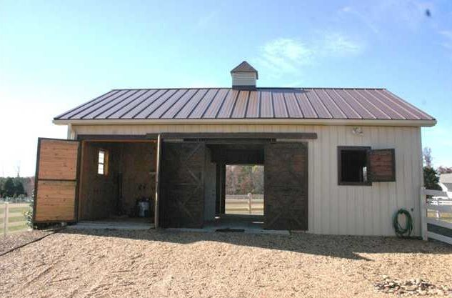Cute two stall horse barn with wash rack and aisle ...