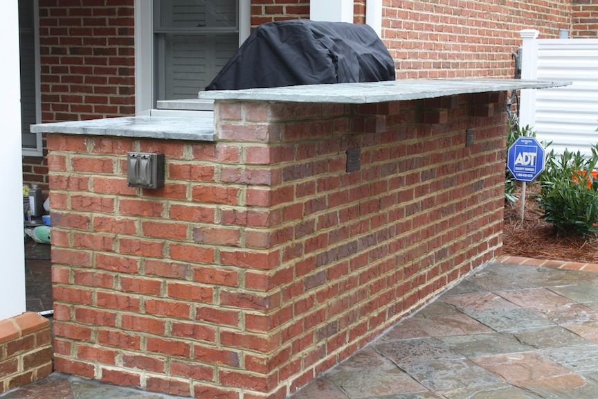 fabulous brick outdoor kitchen   Red Brick Outdoor Kitchen with a Raised Seating Bar ...