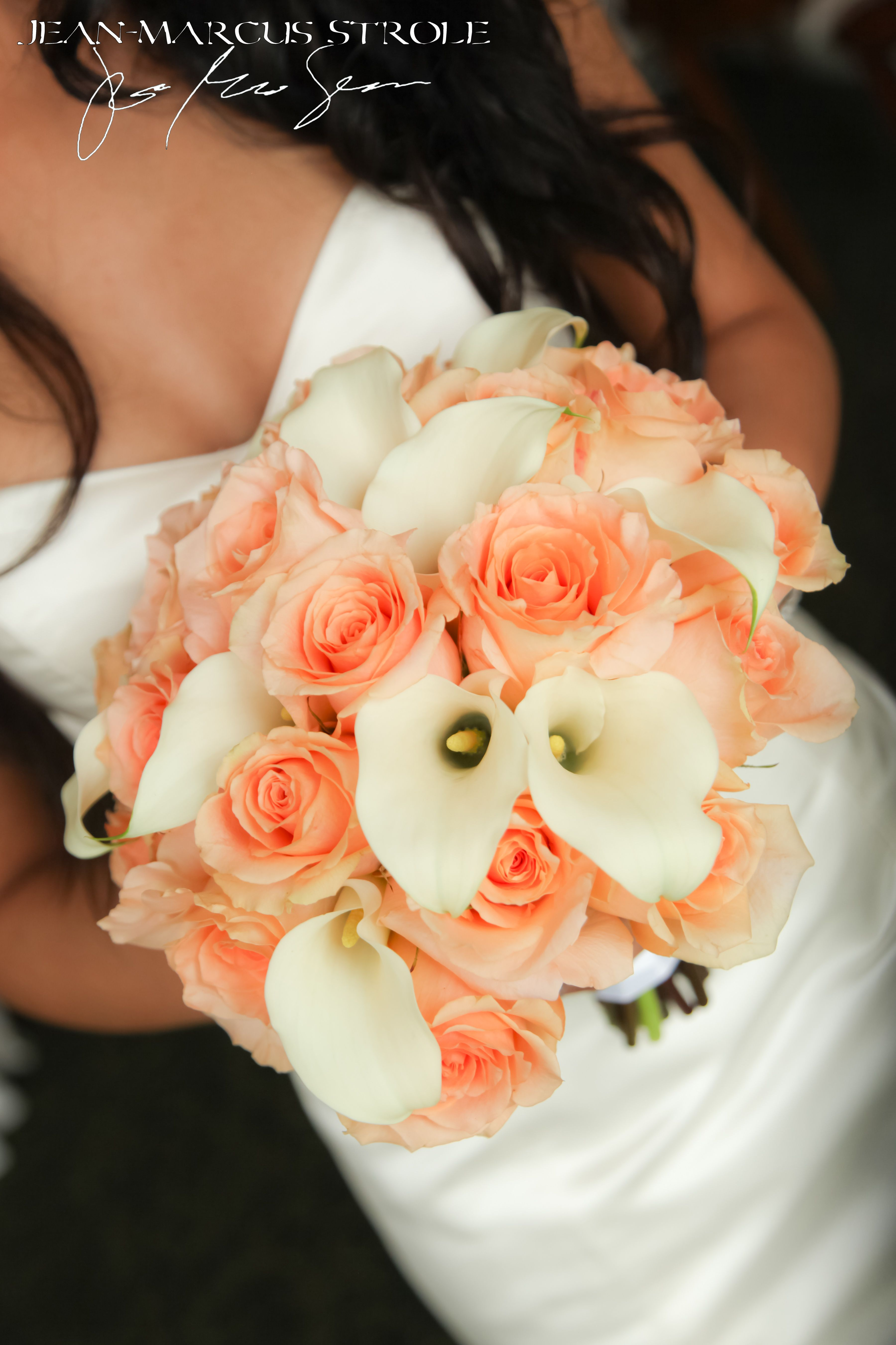 A Peach And White Bouquet With Peach Roses And White Calla Lilies