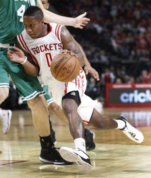 Houston Rockets guard Isaiah Canaan (0) charges for the basket against Boston Celtics center Tyler Zeller (44) during the second half of an NBA basketball game at Toyota Center, Saturday, Nov. 1, 2014, in Houston. ( Karen Warren / Houston Chronicle  )