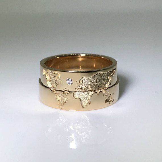 World map wedding bands. His and hers wedding rings set. Matching