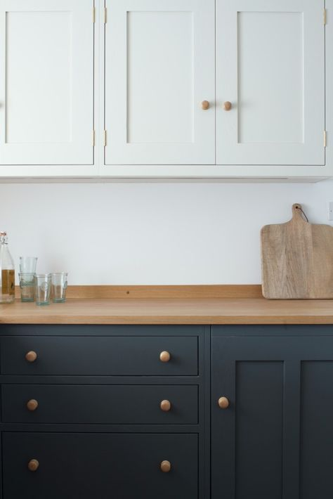 We created the classic shaker style, cosy stone cottage kitchen in a small space while enhancing the feeling of space by splitting the cabinetry colours.