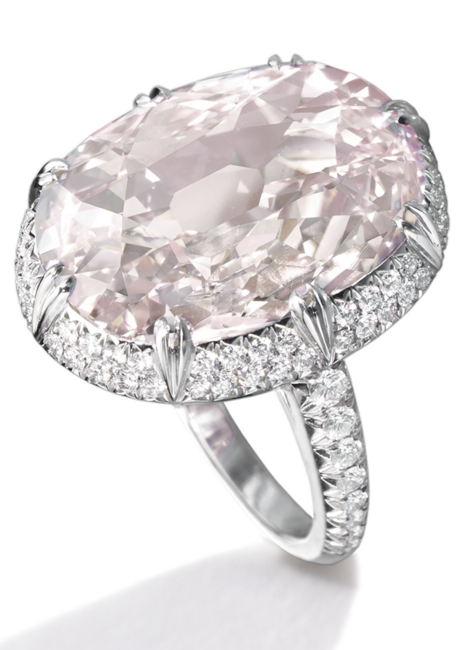 A Magnificent and Rare Light Pink Diamond Ring The oval diamond of light pink color weighing 10.46 carats, the mounting pavé-set with small round diamonds, mounted in platinum.