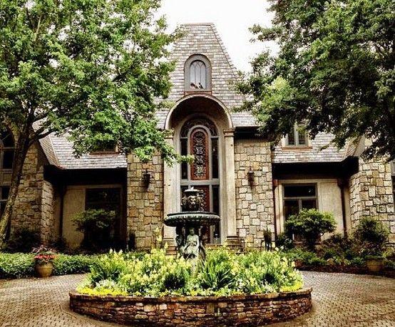 Mansion with a circular drive plus a fountain
