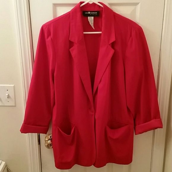 Red blazer Stretchy red polyester rayon blazer with 1 button front and 2 front pockets.  Sleeves can be rolled or straight.  Shoulder pads. Machine washable. Sag Harbor Jackets & Coats Blazers