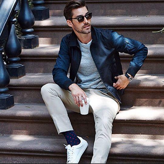 Dark Blue / Navy Harrington Jacket . Light Marl Grey T-Shirt . Ivory / Ecru Chinos . Navy Socks . White Plimsolls / Trainers