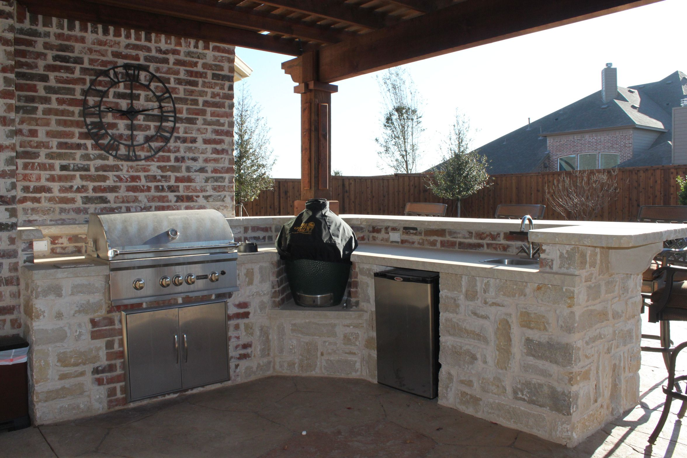 outdoor kitchen with bbq smoker refrigerator and sink dream