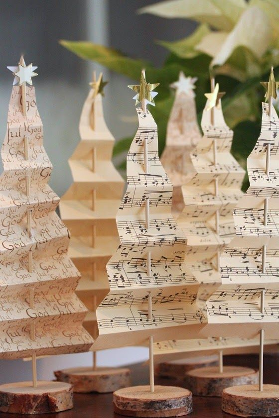 clever use of old sheet music used to create a forest of decorative christmas trees alberi
