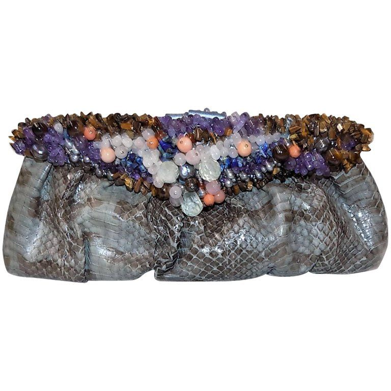 e8d41e071c85 For Sale on 1stdibs - Spectacular Handmade python bag  clutch with  clustered frame of semi precious stones. One of a kind! Heavy frame  designed with pink ...