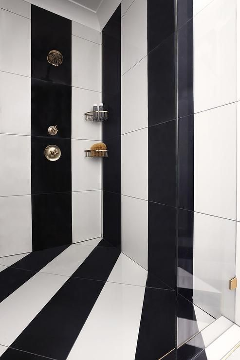 White and black striped vertical tiles accent a seamless glass walk ...