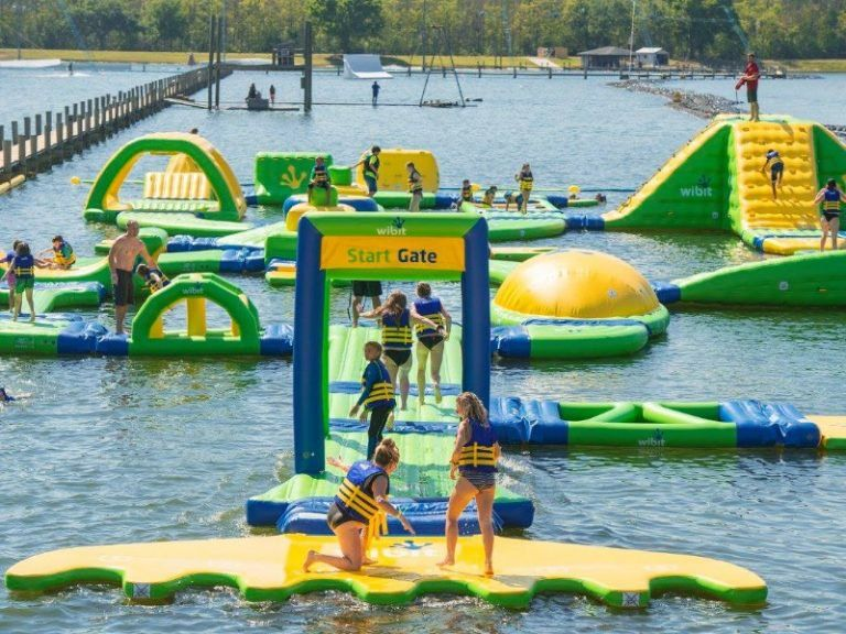 Beat The Heat This Summer At Central Florida S First Aquapark Tripstodiscover Inflatable Water Park Heart Healthy Dinners Florida Hotels
