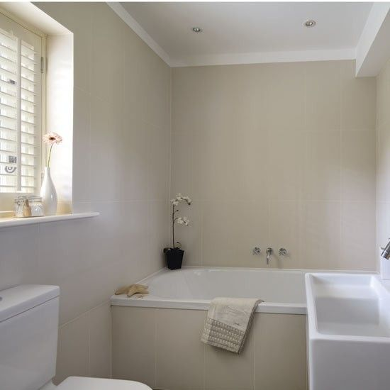 cream bathroom with plantation shutters on the window