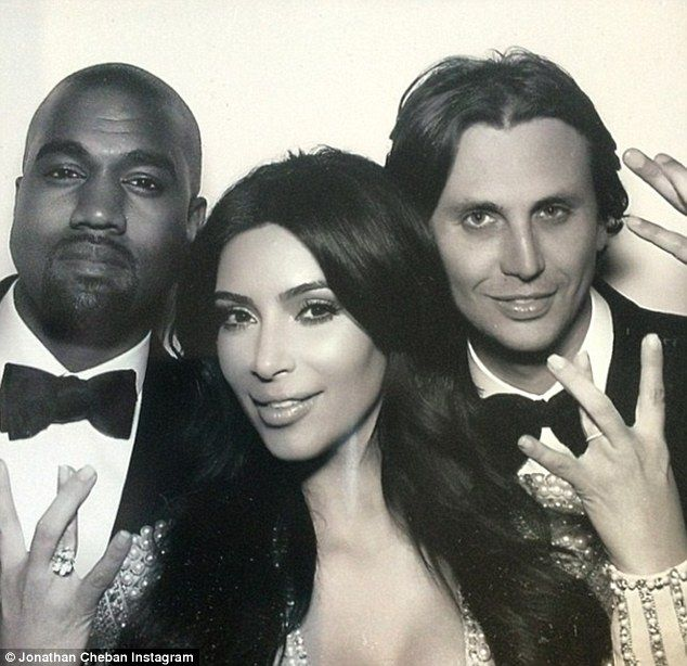 First glimpse of the ring: Kim Kardashian West shows off her wedding band in a photo-booth shot on her left hand, with her engagement finger on her right alongside Kanye West & her friend Jonathan Cheban